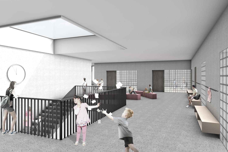 Innenansicht: Zenital belichtete Pausenhalle mit Lernecke
