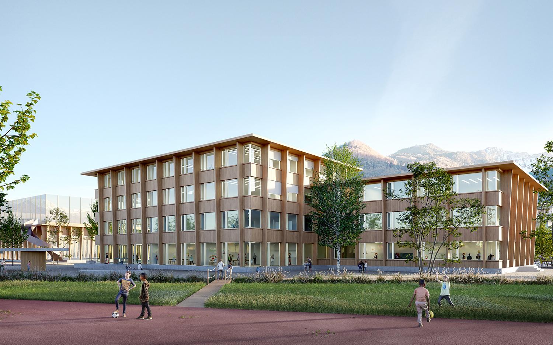Vertikal laufende Holzstützen und die weit ausladenden Vordächer sind prägende Elemente der neuen Schulanlage